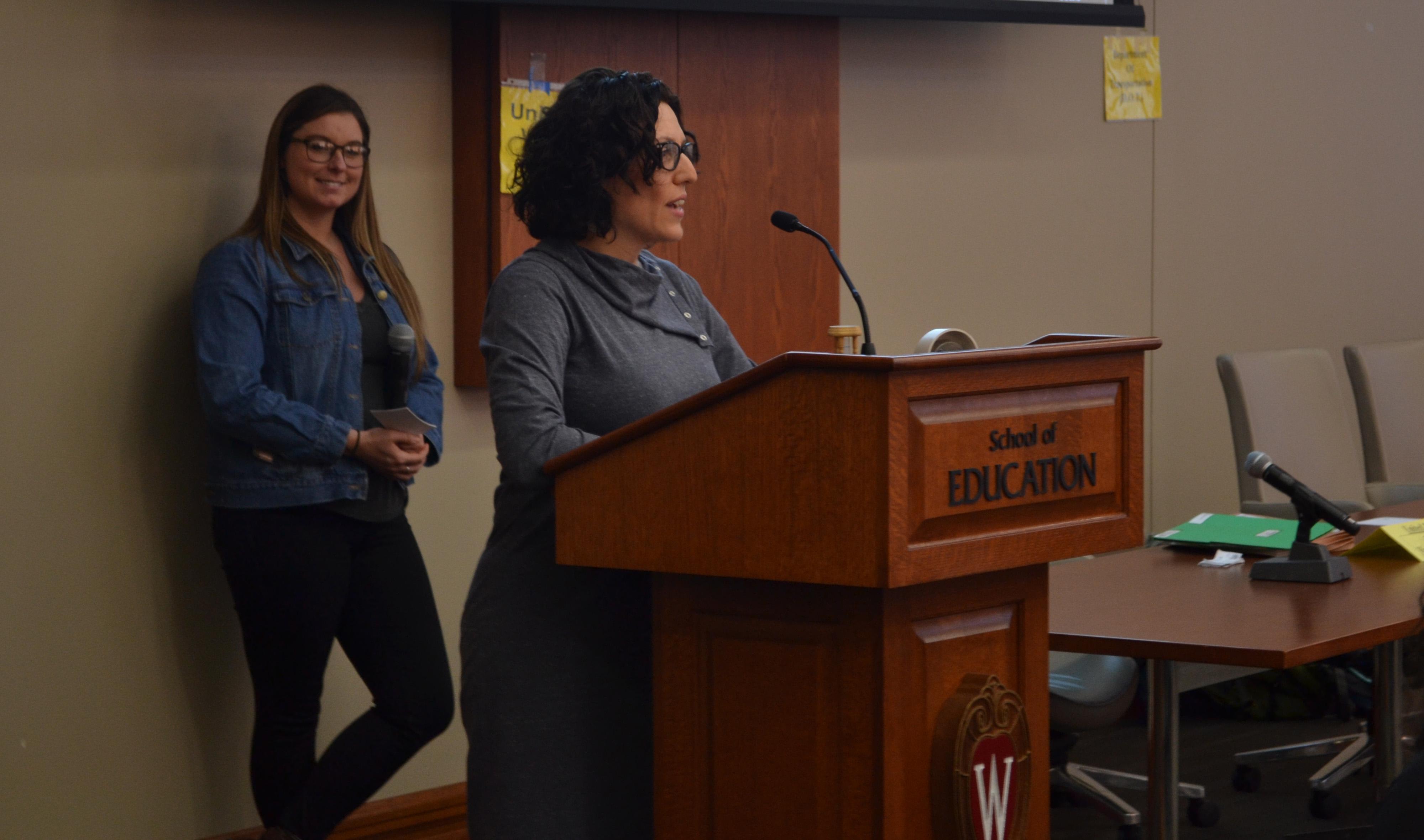 Pajarita Charles (at lectern) and Shawna Lutzow of Madison-area Urban Ministry